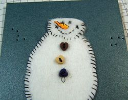 Quilt snowman arm close up